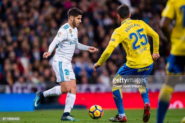 Marco Asensio Willemsen of Real Madrid fights for the ball with Alberto Aquilani of UD Las Palmas during the La Liga 201718 match between Real Madrid...