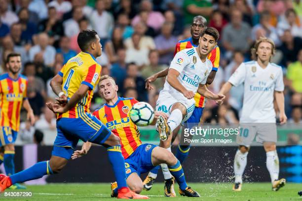 Marco Asensio Willemsen of Real Madrid fights for the ball with Antonio Latorre Grueso Lato of Valencia CF during their La Liga 201718 match between...