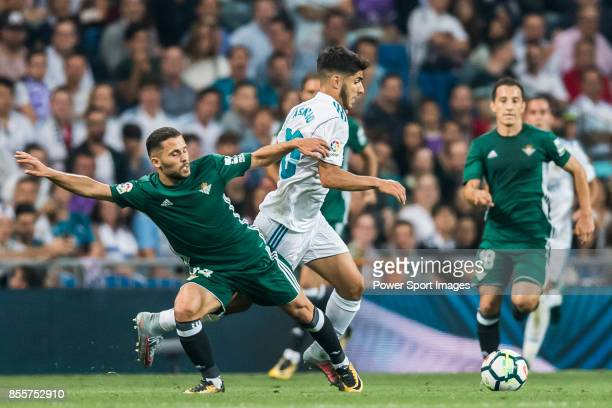 Marco Asensio Willemsen of Real Madrid fights for the ball with Riza Durmisi of Real Betis during the La Liga 201718 match between Real Madrid and...