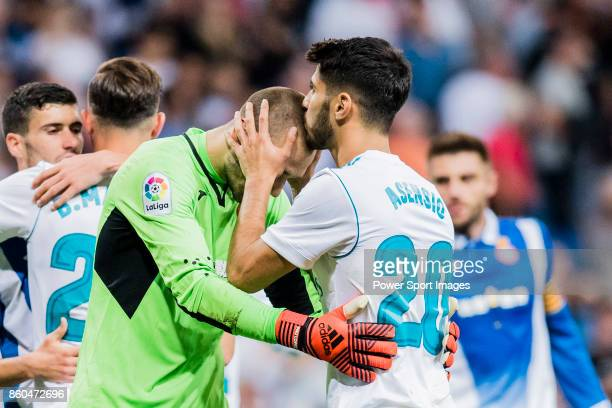 Marco Asensio Willemsen of Real Madrid kisses Goalkeeper Pau Lpez Sabata of RCD Espanyol on his head after the La Liga 201718 match between Real...