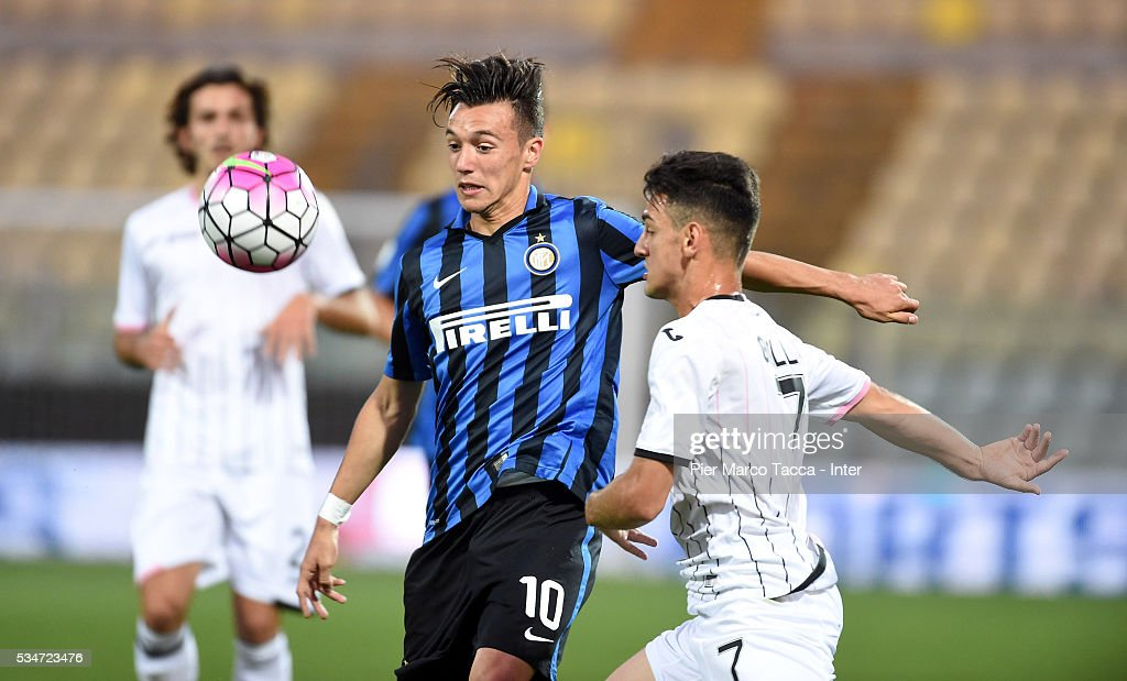 Marco Baldini of FC Internazionale competes for the ball with Paolo Grillo of US Citta di Palermo during the juvenile playoff match between FC Internazionale and US Citta di Palermo on May 27, 2016 in Modena, Italy.