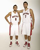 Marco Belinelli and Andrea Bargnani of the Toronto Raptors pose for a portrait during 2009 NBA Media Day on September 28 2009 at Air Canada Centre in...