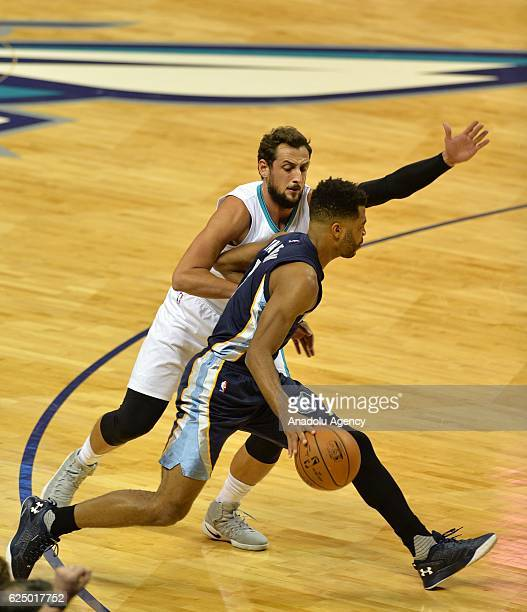Marco Belinelli of Charlotte Hornets blocks Andrew Harrison of Memphis Grizzlies during the NBA match between Memphis Grizzlies vs Charlotte Hornets...