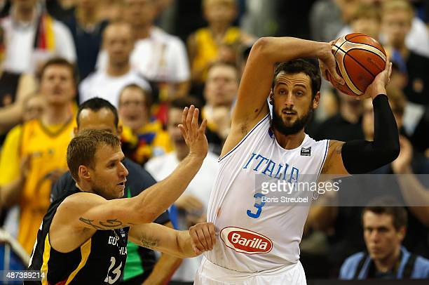 Marco Belinelli of Italy drives to the basket against Anton Gavel of Germany during the FIBA EuroBasket 2015 Group B basketball match between Italy...