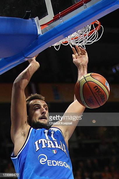 Marco Belinelli of Italy dunks the ball during the EuroBasket 2011 first round group B match between Latvia and Italy at Siauliai Arena on September...