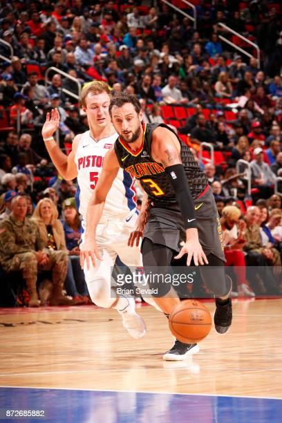 Marco Belinelli of the Atlanta Hawks handles the ball against Luke Kennard of the Detroit Pistons on November 10 2017 at Little Caesars Arena in...