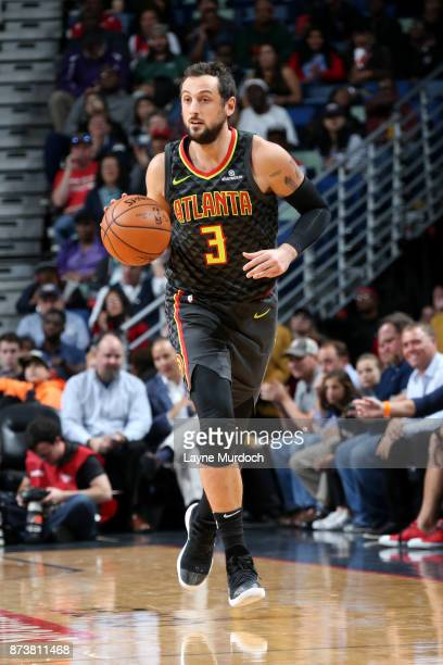 Marco Belinelli of the Atlanta Hawks handles the ball during the game against the New Orleans Pelicans on November 13 2017 at Smoothie King Center in...