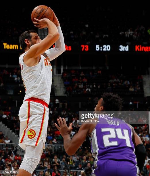 Marco Belinelli of the Atlanta Hawks shoots against Buddy Hield of the Sacramento Kings at Philips Arena on November 15 2017 in Atlanta Georgia NOTE...