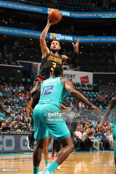 Marco Belinelli of the Atlanta Hawks shoots the ball during the game against the Charlotte Hornets on October 20 2017 at Spectrum Center in Charlotte...