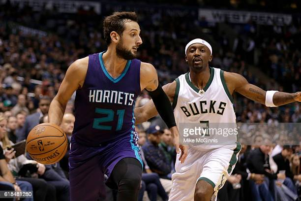 Marco Belinelli of the Charlotte Hornets dribbles the basketball as Jason Terry of the Milwaukee Bucks defends during the fourth quarter at BMO...