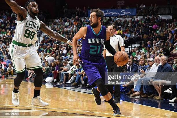 Marco Belinelli of the Charlotte Hornets drives to the basket against the Boston Celtics during a preseason game on October 8 2016 at the Mohegan Sun...