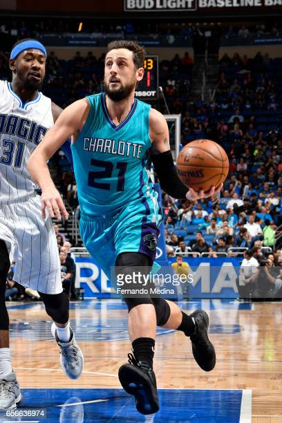 Marco Belinelli of the Charlotte Hornets drives to the basket against the Orlando Magic on March 22 2017 at Amway Center in Orlando Florida NOTE TO...