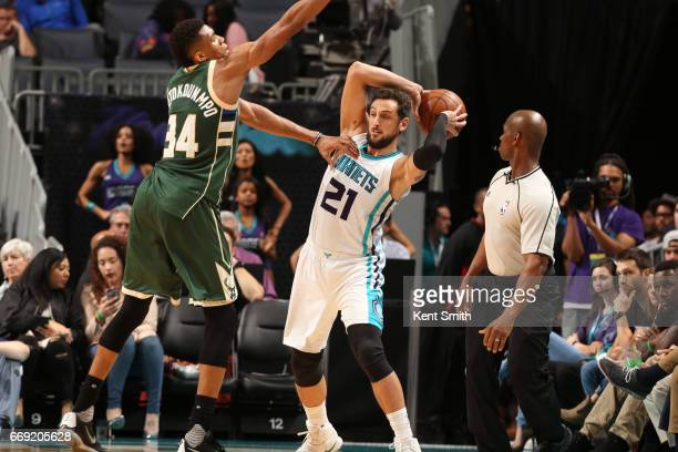 Marco Belinelli of the Charlotte Hornets looks to pass against the Milwaukee Bucks on March 28 2017 at Spectrum Center in Charlotte North Carolina...