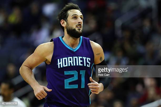 Marco Belinelli of the Charlotte Hornets runs up the floor after scoring against the Washington Wizards at Verizon Center on December 14 2016 in...