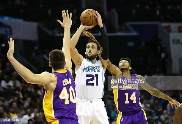 Marco Belinelli of the Charlotte Hornets shoots over teammates Ivica Zubac and Brandon Ingram of the Los Angeles Lakers during their game at Spectrum...