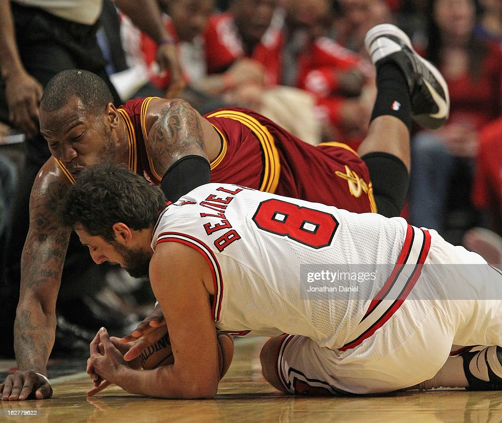 <a gi-track='captionPersonalityLinkClicked' href=/galleries/search?phrase=Marco+Belinelli&family=editorial&specificpeople=847592 ng-click='$event.stopPropagation()'>Marco Belinelli</a> #8 of the Chicago Bulls and <a gi-track='captionPersonalityLinkClicked' href=/galleries/search?phrase=Marreese+Speights&family=editorial&specificpeople=4187263 ng-click='$event.stopPropagation()'>Marreese Speights</a> #15 of the Cleveland Cavaliers dive for a loose ball at the United Center on February 26, 2013 in Chicago, Illinois.