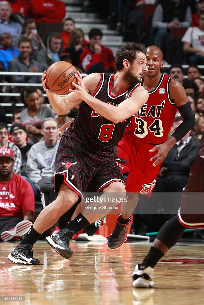 Marco Belinelli #8 of the Chicago Bulls controls the ball against Ray Allen #34 of the Miami Heat on February 21, 2013 at the United Center in Chicago, Illinois.