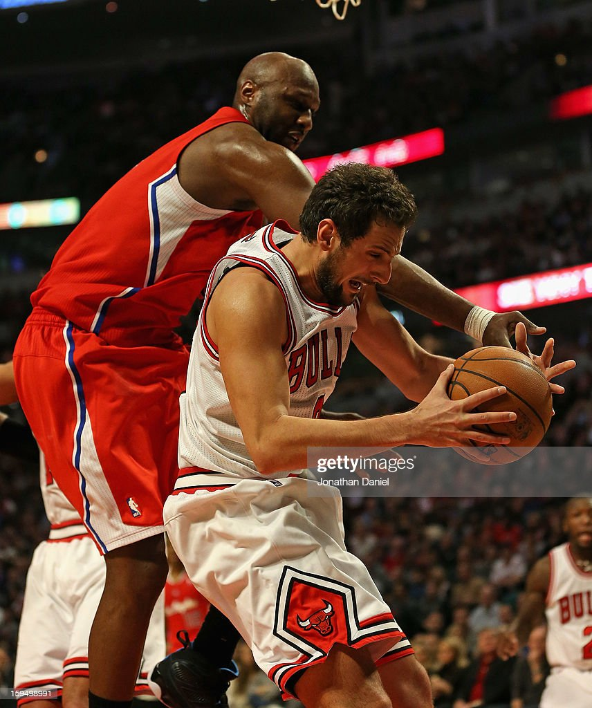 <a gi-track='captionPersonalityLinkClicked' href=/galleries/search?phrase=Marco+Belinelli&family=editorial&specificpeople=847592 ng-click='$event.stopPropagation()'>Marco Belinelli</a> #8 of the Chicago Bulls controls the ball under pressure from <a gi-track='captionPersonalityLinkClicked' href=/galleries/search?phrase=Lamar+Odom&family=editorial&specificpeople=201519 ng-click='$event.stopPropagation()'>Lamar Odom</a> #7 of the Los Angeles Clippers at the United Center on December 11, 2012 in Chicago, Illinois. The Clippers defeated the Bulls 94-89.