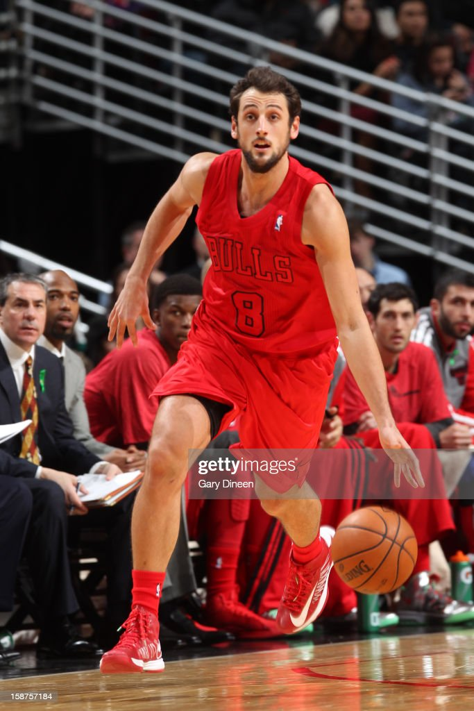 <a gi-track='captionPersonalityLinkClicked' href=/galleries/search?phrase=Marco+Belinelli&family=editorial&specificpeople=847592 ng-click='$event.stopPropagation()'>Marco Belinelli</a> #8 of the Chicago Bulls dribbles the ball up court against the Houston Rockets during a Christmas Day game on December 25, 2012 at the United Center in Chicago, Illinois.