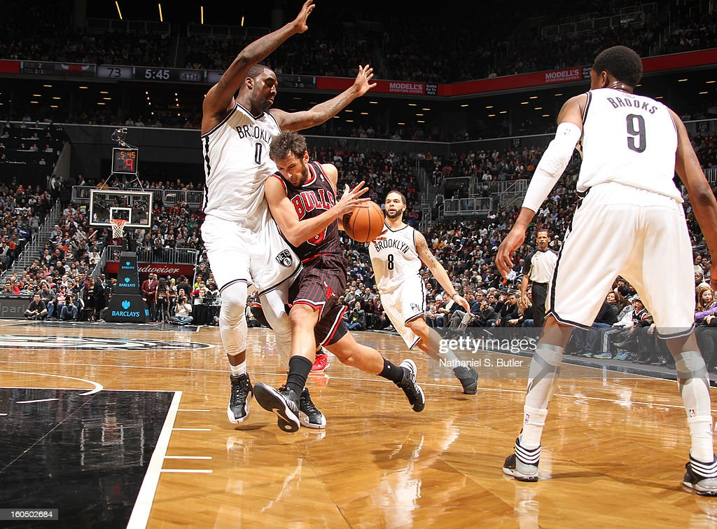 <a gi-track='captionPersonalityLinkClicked' href=/galleries/search?phrase=Marco+Belinelli&family=editorial&specificpeople=847592 ng-click='$event.stopPropagation()'>Marco Belinelli</a> #8 of the Chicago Bulls drives to the basket against the Brooklyn Nets on February 1, 2013 at the Barclays Center in the Brooklyn borough of New York City.