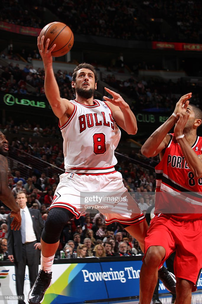 <a gi-track='captionPersonalityLinkClicked' href=/galleries/search?phrase=Marco+Belinelli&family=editorial&specificpeople=847592 ng-click='$event.stopPropagation()'>Marco Belinelli</a> #8 of the Chicago Bulls goes to the basket against <a gi-track='captionPersonalityLinkClicked' href=/galleries/search?phrase=Nicolas+Batum&family=editorial&specificpeople=3746275 ng-click='$event.stopPropagation()'>Nicolas Batum</a> #88 of the Portland Trail Blazers on March 21, 2013 at the United Center in Chicago, Illinois.