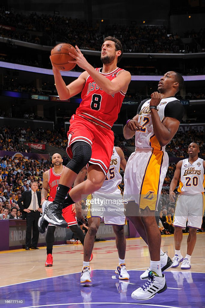 <a gi-track='captionPersonalityLinkClicked' href=/galleries/search?phrase=Marco+Belinelli&family=editorial&specificpeople=847592 ng-click='$event.stopPropagation()'>Marco Belinelli</a> #8 of the Chicago Bulls goes to the basket against <a gi-track='captionPersonalityLinkClicked' href=/galleries/search?phrase=Dwight+Howard&family=editorial&specificpeople=201570 ng-click='$event.stopPropagation()'>Dwight Howard</a> #12 of the Los Angeles Lakers at Staples Center on March 10, 2013 in Los Angeles, California.
