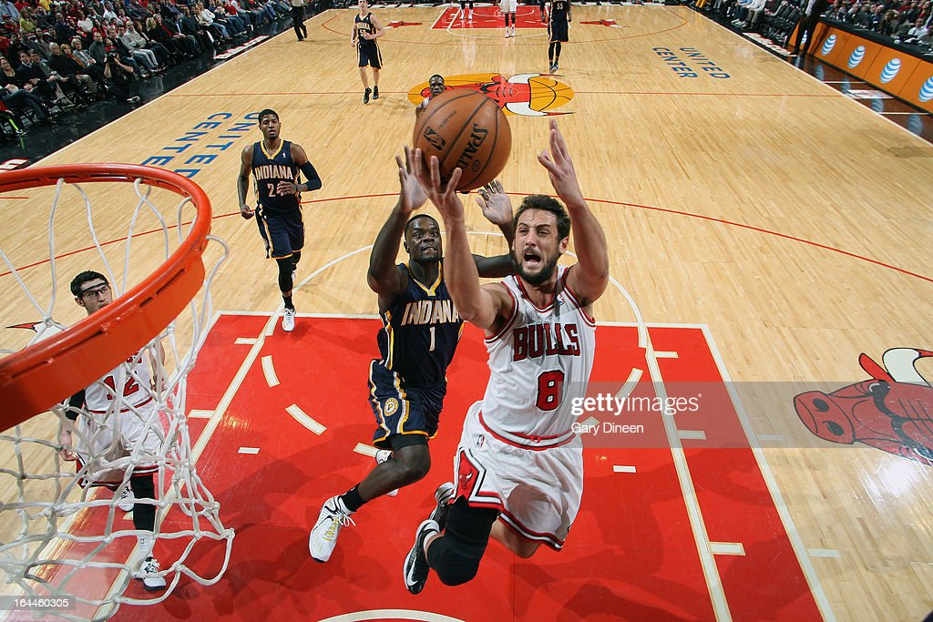 Marco Belinelli #8 of the Chicago Bulls goes to the basket ahead of Lance Stephenson #1 of the Indiana Pacers on March 23, 2013 at the United Center in Chicago, Illinois.