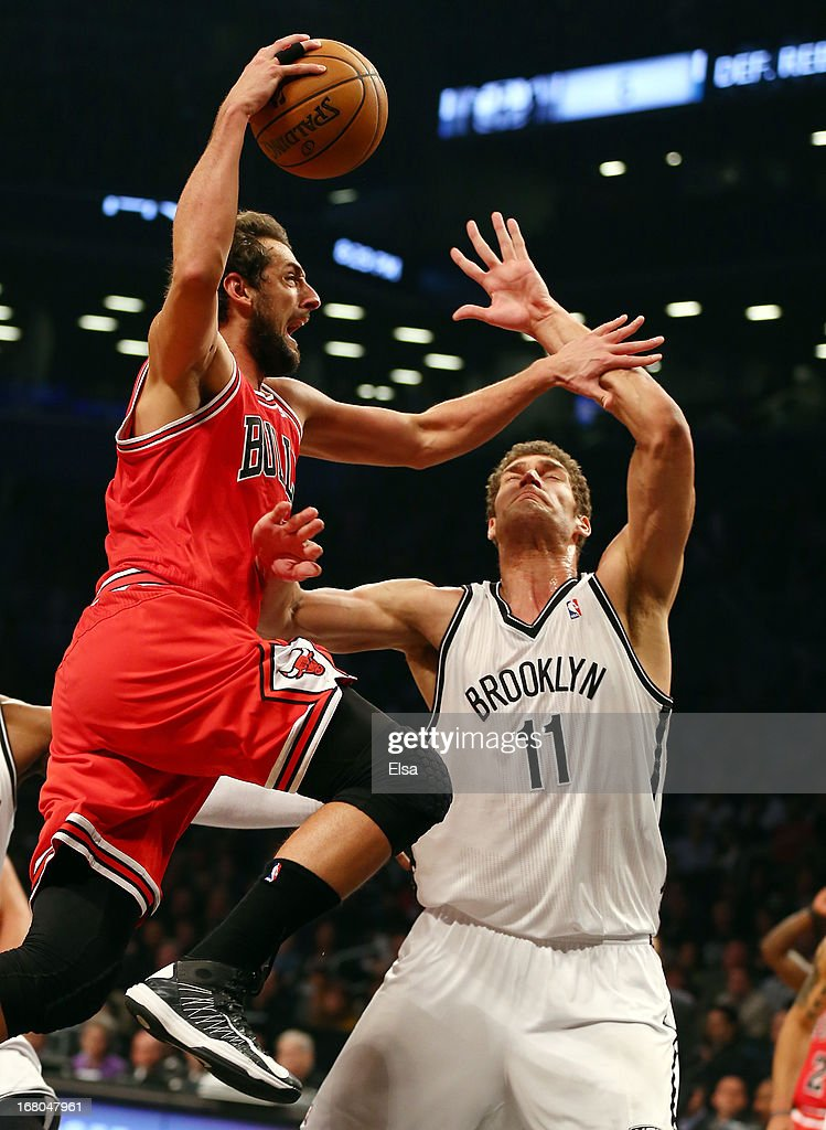 Marco Belinelli #8 of the Chicago Bulls heads for the basket as Brook Lopez #11 of the Brooklyn Nets defends during Game Seven of the Eastern Conference Quarterfinals of the 2013 NBA Playoffs on May 4, 2013 at the Barclays Center in the Brooklyn borough of New York City.