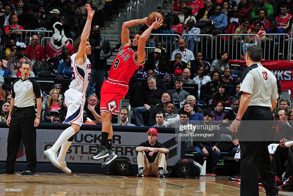 Marco Belinelli #8 of the Chicago Bulls looks to pass the ball against the Atlanta Hawks on February 2, 2013 at Philips Arena in Atlanta, Georgia.