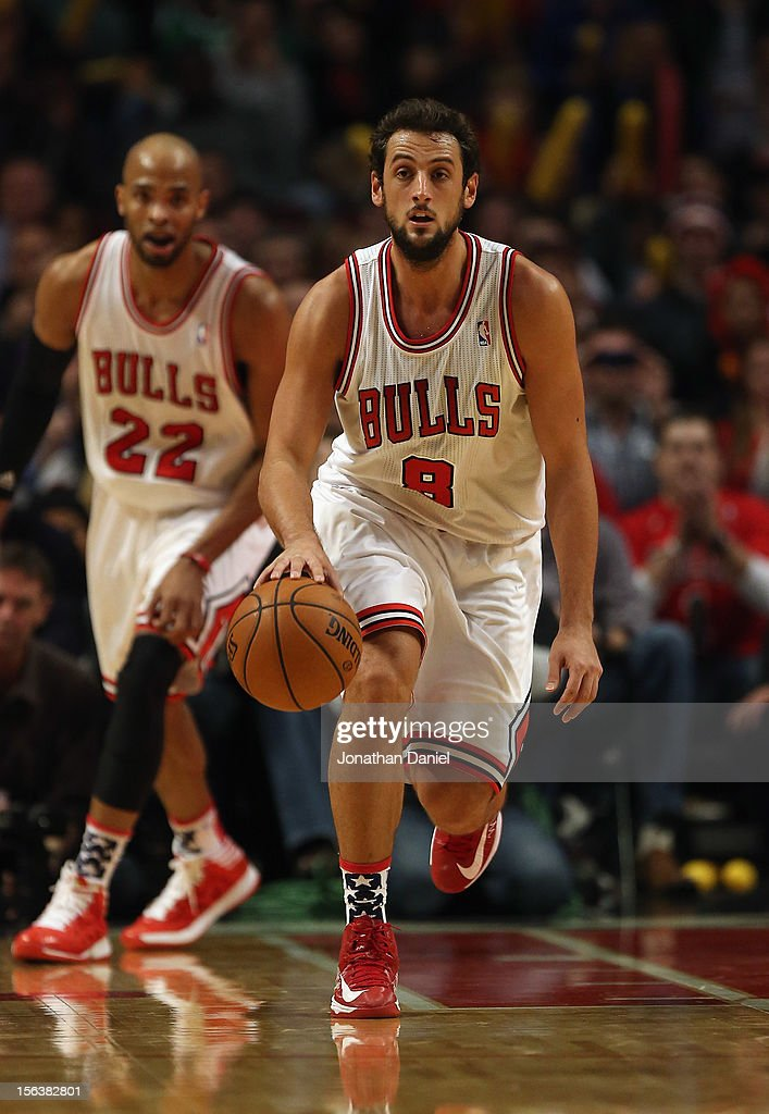 Marco Belinelli #8 of the Chicago Bulls moves up the court in front of teammate Taj Gibson #22 against the Boston Celtics at the United Center on November 12, 2012 in Chicago, Illinois. The Celtics defeated the Bulls 101-95.