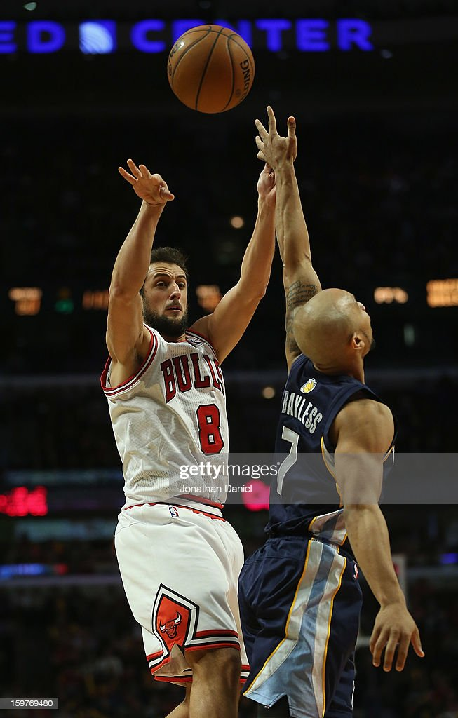 Marco Belinelli #8 of the Chicago Bulls passes over Jerryd Bayless #7 of the Memphis Grizzles at the United Center on January 19, 2013 in Chicago, Illinois. The Grizzlies defeated the Bulls 85-82 in overtime.