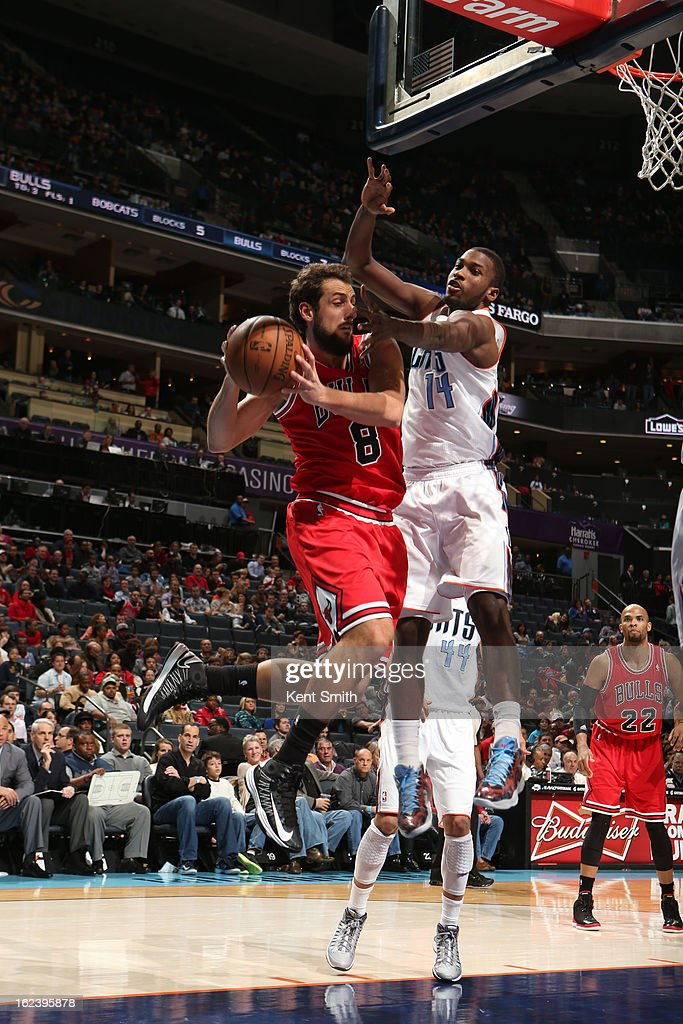 <a gi-track='captionPersonalityLinkClicked' href=/galleries/search?phrase=Marco+Belinelli&family=editorial&specificpeople=847592 ng-click='$event.stopPropagation()'>Marco Belinelli</a> #8 of the Chicago Bulls passes the ball against <a gi-track='captionPersonalityLinkClicked' href=/galleries/search?phrase=Michael+Kidd-Gilchrist&family=editorial&specificpeople=8526214 ng-click='$event.stopPropagation()'>Michael Kidd-Gilchrist</a> #14 of the Charlotte Bobcats at the Time Warner Cable Arena on February 22, 2013 in Charlotte, North Carolina.