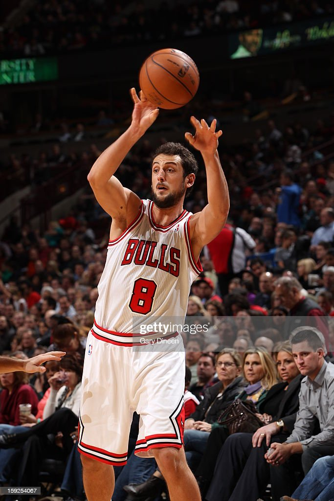Marco Belinelli #8 of the Chicago Bulls passes the ball against the Milwaukee Bucks on January 9, 2013 at the United Center in Chicago, Illinois.