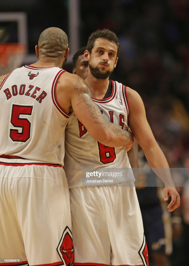 Marco Belinelli #8 of the Chicago Bulls reacts after hitting the game-winning shot against the Utah Jazz as he gets a hug from teammate Carlos Boozer #5 at the United Center on March 8, 2013 in Chicago, Illinois. The Bulls defeated the Jazz 89-88.
