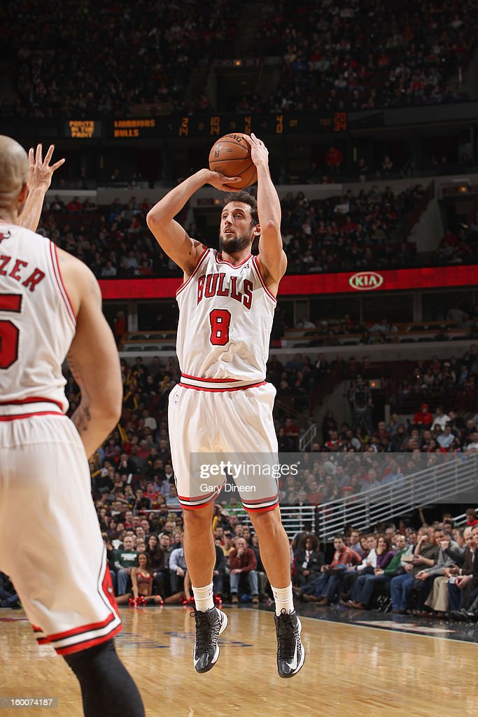<a gi-track='captionPersonalityLinkClicked' href=/galleries/search?phrase=Marco+Belinelli&family=editorial&specificpeople=847592 ng-click='$event.stopPropagation()'>Marco Belinelli</a> #8 of the Chicago Bulls shoots against the Golden State Warriors on January 25, 2012 at the United Center in Chicago, Illinois.