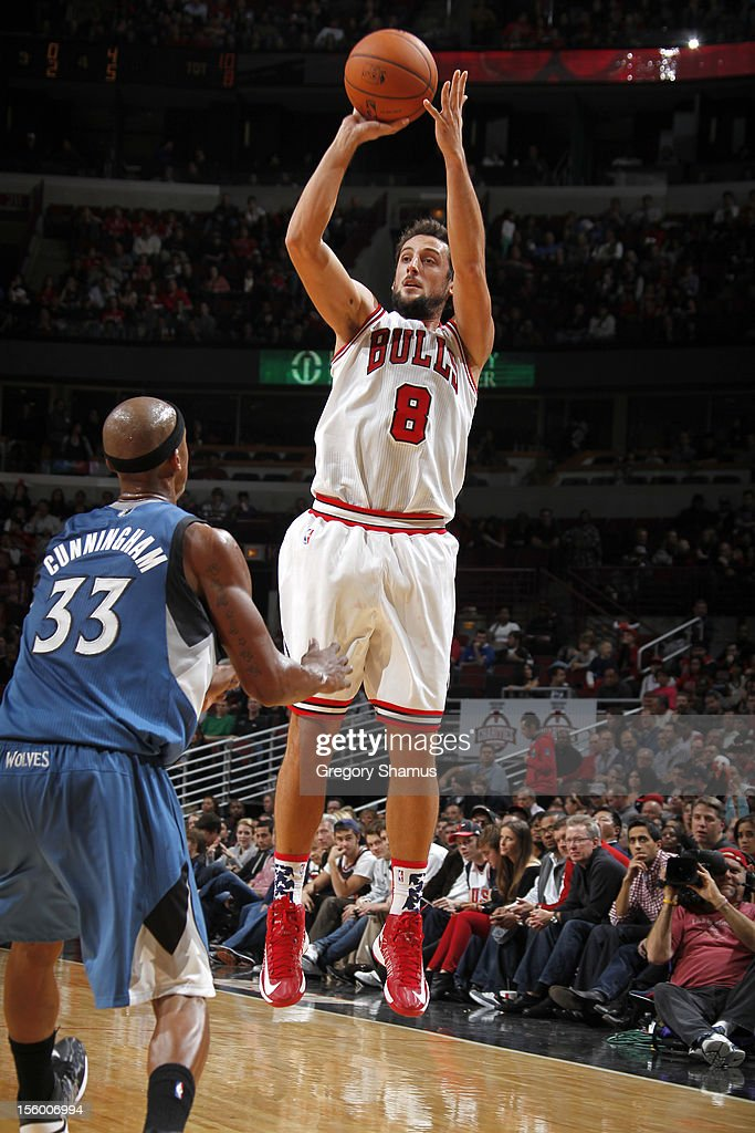 <a gi-track='captionPersonalityLinkClicked' href=/galleries/search?phrase=Marco+Belinelli&family=editorial&specificpeople=847592 ng-click='$event.stopPropagation()'>Marco Belinelli</a> #8 of the Chicago Bulls shoots over <a gi-track='captionPersonalityLinkClicked' href=/galleries/search?phrase=Dante+Cunningham&family=editorial&specificpeople=683729 ng-click='$event.stopPropagation()'>Dante Cunningham</a> #33 of the Minnesota Timberwolves on November 10, 2012 at the United Center in Chicago, Illinois.