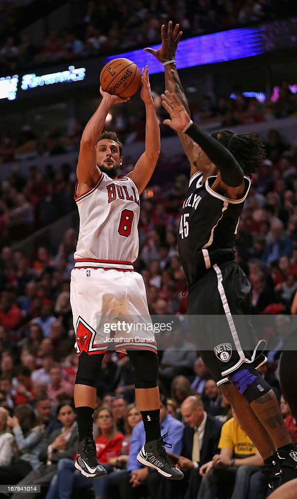 Marco Belinelli #8 of the Chicago Bulls shoots over Gerald Wallace #45 of the Brooklyn Nets on his way to a game-high 22 points in Game Six of the Eastern Conference Quarterfinals during the 2013 NBA Playoffs at the United Center on May 2, 2013 in Chicago, Illinois. The Nets defeated the Bulls 95-92.