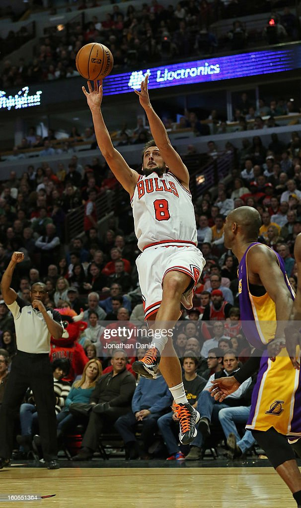 Marco Belinelli #8 of the Chicago Bulls shoots over Kobe Bryant #24 of the Los Angeles Lakers at the United Center on January 21, 2013 in Chicago, Illinois. The Bulls defeated the Lakers 95-83.