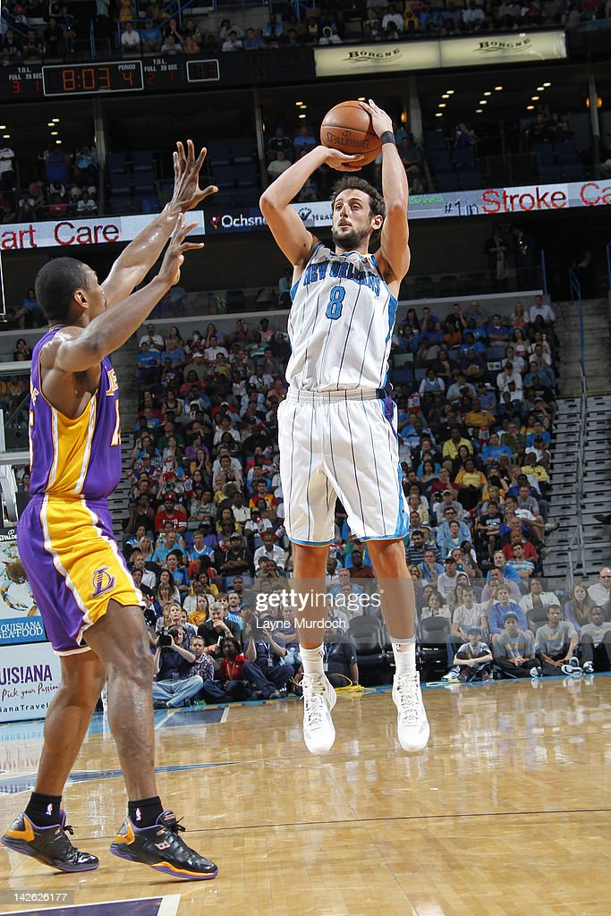 <a gi-track='captionPersonalityLinkClicked' href=/galleries/search?phrase=Marco+Belinelli&family=editorial&specificpeople=847592 ng-click='$event.stopPropagation()'>Marco Belinelli</a> #8 of the New Orleans Hornets shoots against Metta World Peace #15 of the Los Angeles Lakers on April 9, 2012 at the New Orleans Arena in New Orleans, Louisiana.