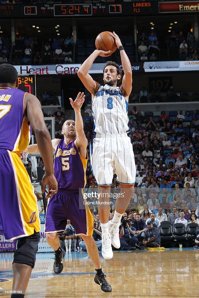 <a gi-track='captionPersonalityLinkClicked' href=/galleries/search?phrase=Marco+Belinelli&family=editorial&specificpeople=847592 ng-click='$event.stopPropagation()'>Marco Belinelli</a> #8 of the New Orleans Hornets shoots against <a gi-track='captionPersonalityLinkClicked' href=/galleries/search?phrase=Steve+Blake&family=editorial&specificpeople=204474 ng-click='$event.stopPropagation()'>Steve Blake</a> #5 of the Los Angeles Lakers on April 9, 2012 at the New Orleans Arena in New Orleans, Louisiana.