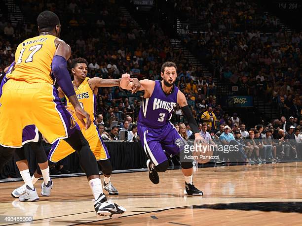 Marco Belinelli of the Sacramento Kings dribbles the ball against the Los Angeles Lakers during a preseason game at MGM Grand Garden Arena on October...