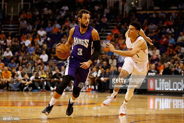 Marco Belinelli of the Sacramento Kings handles the ball during the preseason NBA game against the Phoenix Suns at Talking Stick Resort Arena on...