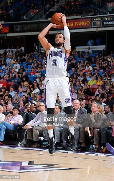 Marco Belinelli of the Sacramento Kings shoots against the San Antonio Spurs on October 8 2015 at Sleep Train Arena in Sacramento California NOTE TO...