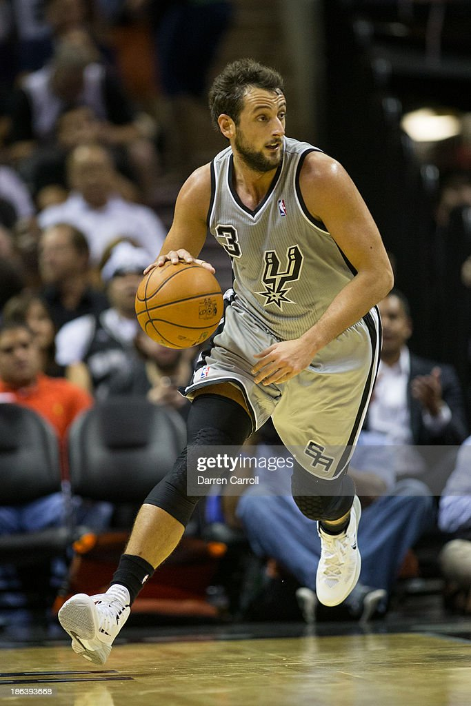 <a gi-track='captionPersonalityLinkClicked' href=/galleries/search?phrase=Marco+Belinelli&family=editorial&specificpeople=847592 ng-click='$event.stopPropagation()'>Marco Belinelli</a> #3 of the San Antonio Spurs brings the ball down court in a game against the Memphis Grizzlies on October 30, 2013 at the AT&T Center in San Antonio, Texas.