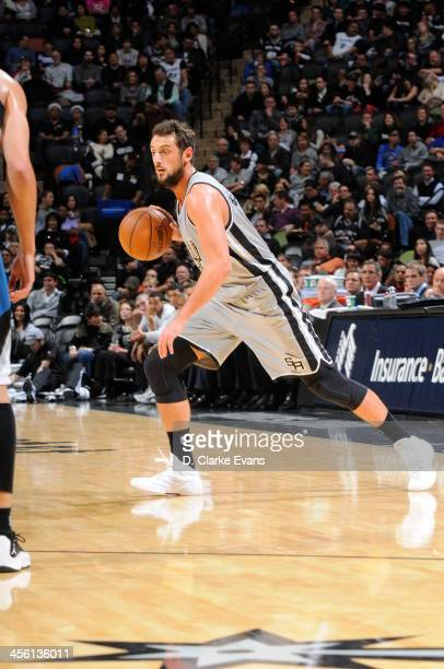 Marco Belinelli of the San Antonio Spurs drives against the Minnesota Timberwolves at the ATT Center on December 13 2013 in San Antonio Texas NOTE TO...