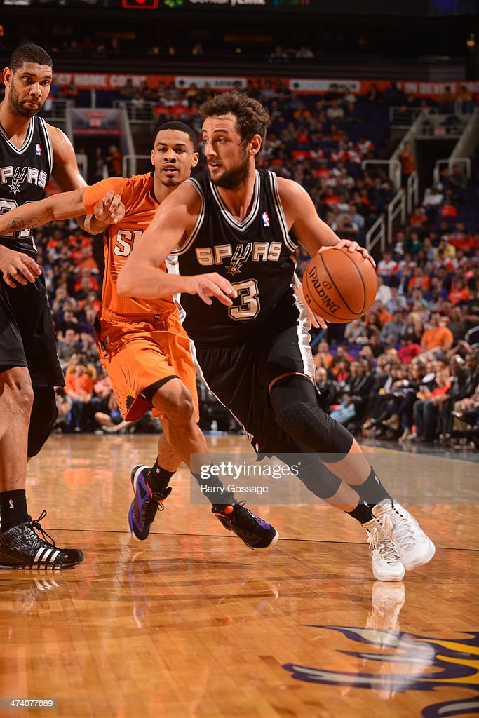 Marco Belinelli #3 of the San Antonio Spurs drives against the Phoenix Suns] on February 21, 2014 at U.S. Airways Center in Phoenix, Arizona.