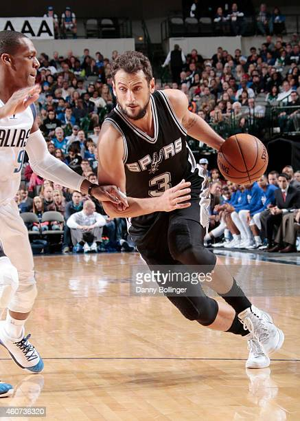 Marco Belinelli of the San Antonio Spurs drives to the basket against the Dallas Mavericks during the game on December 20 2014 at American Airlines...