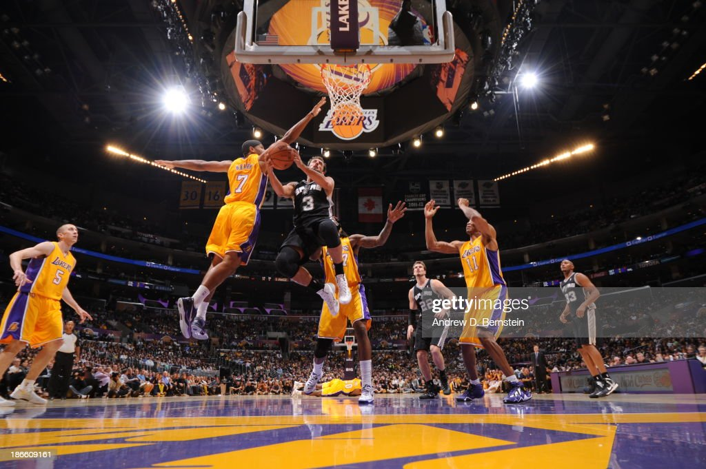Marco Belinelli #3 of the San Antonio Spurs goes to the basket against Xavier Henry #7 of the Los Angeles Lakers on November 1, 2013 at STAPLES Center in Los Angeles, California.