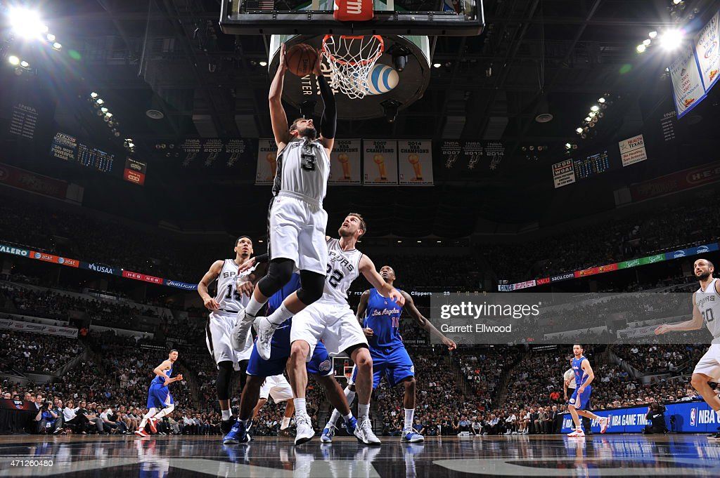 Marco Belinelli #3 of the San Antonio Spurs grabs a rebound against the Los Angeles Clippers during Game Four of the Western Conference Quarterfinals at the AT&T Center on April 26, 2015 in San Antonio, Texas.