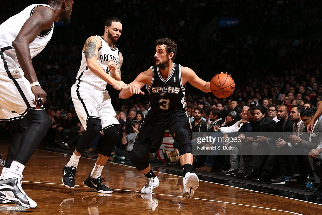 <a gi-track='captionPersonalityLinkClicked' href=/galleries/search?phrase=Marco+Belinelli&family=editorial&specificpeople=847592 ng-click='$event.stopPropagation()'>Marco Belinelli</a> #3 of the San Antonio Spurs handles the ball against the Brooklyn Nets at the Barclays Center on February 06, 2014 in the Brooklyn borough of New York City.